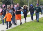 Participants in the Huntington County CROP Hunger Walk make their way down MacGahan Street near Huntington North High School during the event, which was held on Sunday, Oct. 5.