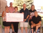 The Huntington North High School Class of 1979 Reunion Committee donated $1,578 to the By the Book program on Thursday, Aug. 15, at Huntington North. The donated funds were contributed by members of Huntington North's Class of 1979 at the group's 40th anniversary celebration, held in July. Pictured are (front row from left) Judy Stahl Lee, treasurer, By the Book; Cathy Nowels Anderson, chair, Class of 1979 Reunion Committee; and Mike Anderson and Bob Burnsworth, both reunion committee; and (back row from left) Mike Keplinger, reunion committee; and Christine Smith Walker, class of 1979 member.