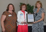 """Teresa Ray (center) was named the Forks of the Wabash chapter of the American Business Women's Association """"Woman of the Year"""" on Wednesday night, May 18, at the group's 33rd annual Business Associate and Education Night at Huntington University. With Ray are (from left) Event Chairman Angela Smith and Vice President Vicki Pearson."""