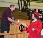 Kandice Grimme (right) accepts an award from Huntington North High School teacher Joe Perkins for earning all A's in French throughout her four years of high school.