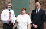 Huntington resident Natalie Fouts (center) accepts the grand prize of two Allegiant Air tickets from the Huntington County EXPO from EXPO co-chairmen Scott Trauner (left) and Jim Scheiber on Monday, March 29.