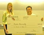 Alicia Aldridge (left), a 2007 Huntington North graduate, was presented with the 2010 Vine & Branch Excellence in Urban Forestry award at Purdue University. Presenting the check is Judson Scott, president of Vine & Branch.