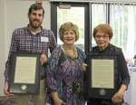Huntington University President Sherilyn Pemberton (center) stands with Janet Clark (right), recipient of the university's Distinguished Alumni Citation, and Jonathan Brenneman, who was named Young Alumnus of the Year.