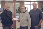 The Andrews Alumni Association recently donated a check to Andrews Elementary School to purchase new picnic tables for the school courtyard.