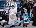 Costumed children — and a dog — parade down the streets of Andrews last Halloween. This year's Halloween party, sponsored by the Andrews Lions Club, is on Saturday, Oct. 31.