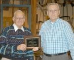 Mark Anson (left), outgoing president of the Huntington County Historical Society, presents the Virginia Miller Award to Robert Fettinger during the society's holiday meeting on Tuesday, Dec. 15.
