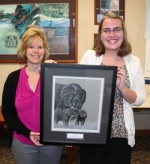 "Huntington North High School junior Ashley Hall (right) displays the graphite and charcoal pencil drawing she created, entitled ""Friends,"" which won the Kappa Kappa Kappa Youth Art Award. Congratulating her on Wednesday, May 18, is Tri Kappa President Sherry Miller (left)."