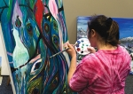Sarah Kenworthy works on an acrylic painting of a peacock at the Creative Abilities Art Studio. Artists from the local studio have works on display and for sale at the ReNEWal Art Show at the First Presbyterian Church, in Fort Wayne.