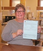 Huntington County Assessor Terri L. Boone holds a Form 11, a notice of assessment of land and improvements, which will be mailed to all property owners in Huntington County today, Monday, March 26. This notice shows the previous assessment and the new assessment of property, effective Jan. 1, 2018.