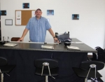 Bart Berry, owner of B.B. Vape, stands behind his vapor tasting bar, where customers are welcome to try his custom e-liquid — available in 44 flavors — for free.
