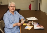 """Dixie Harrold, of Huntington County Right to Life, looks over some of the entries in the 33rd annual """"People's Choice"""" Baby Photo Contest on Thursday, July 10. The deadline for entries is today, Monday, July 14, at 6 p.m."""