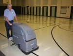 Randy Denton, custodian at Northwest Elementary School, buffs the gymnasium floors in preparation for students' return to school on Wednesday, Aug. 13.