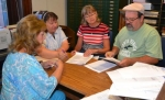 Election officials (from left) Kittie Keiffer, Pam Fowler, Lori Guy and Ken Zuk proofread the ballot for the Nov. 4 general election during a meeting of the Huntington County Election Board on Wednesday, Sept. 3.