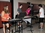 Beth Sikora (left), Michael Molitor (center) and Jo Neal play their xylophones during sectional band practice on Wednesday, July 30. They are led by John Carmichael (far right). The students are members of the percussion section.