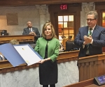 Amanda Banks (left) is awarded the Sagamore of Wabash by the Indiana State Senate on Tuesday, Nov. 17. The award is the highest honor the governor of Indiana can bestow to outstanding Hoosiers.