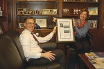 Rep. Jim Banks (R-IN) (left) accepts a framed copy of his Congressional Independent Colleges Caucus Member Spotlight from Barbara K. Mistick, D.M., president of the National Association of Independent Colleges and Universities.