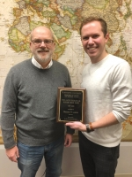 Brooks Walker (right), a student at Huntington University, has been named the winner of the 2019 Jack P. Barlow Sr. History Book Prize. Presenting the award to Walker is Dr. Jeffrey Webb, professor of history at HU. The accolade is given to an outstanding student in the HU Department of History and Political Science's advanced research seminar.