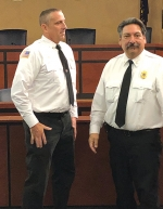 Newly-sworn-in Fort Wayne Fire Department Captain Chad Bauer (left) is congratulated by Assistant Chief and Fort Wayne Fire Marshal Jim Murua following his recent promotion. Bauer, a 15-year veteran of FWFD, is a Huntington native.