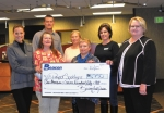 Katie Stam (left), of Beacon Credit Union, and Cheryl McCoy (right), manager of Beacon's Huntington branch, present cash donations to (front, from left) Dawn Stanley, of Helping Paws Pet Haven, and Staci Mathias, of Habitat for Humanity; and (back, from left) Rev. Jimi Staton, of New Life Ministries; and JoAnn Burnau and Maureen Flynn, both of Habitat for Humanity.