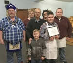 "Hayden Beard (front row at right) holds up a special ""Junior Honorary Member"" award he recently received from the Mt. Etna Masonic Lodge for his service to the lodge. Celebrating the occasion are (front row from left) Reece Beard; and (back row from left) Steve Williams, Cindy Haley, Bob Haley, Diane Beard and Skyler Beard."