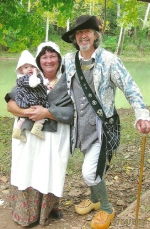 Cindy (left) and Randy Bellamy are dressed in pre-Revolutionary War era garb. Randy Bellamy, who portrays a French trader, will speak at a Huntington County Historical Society program on March 16 about the French influence in Huntington County.