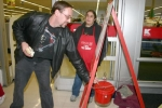 Shane Smith, left, sticks some money in The Salvation Army donation kettle at Kmart on Wednesday, Nov. 25 as volunteer bell-ringer Jayme McFadden looks on. The donation kettles are out around town at various locations, including Big Lots and Walgreens.