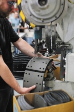 An employee at Bendix Commercial Vehicle Systems, in Huntington, rivets  remanufactured brake  shoes to the same quality standards as original equipment shoes. Bendix recently opened the second phase of its Brake Shoe Remanufacturing Center on Sabine St.