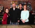 Eli Gearhart (second from left) is the co-owner of The Berg Ale Haus, a new pub in downtown Huntington. The Berg offers both a bar and a family room. Pictured with Gearhart are (first from left) Christi Atkins, assistant bar manager; (third from left) Dena Grover, bartender; and Sara Reust, front of house manager.