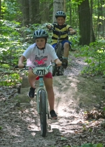 Lilly Helvie (foreground) leads Zander Mason over a log crossing at Kintionki Trail at Salamonie Lake State Forest.