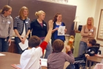"""Huntington University students Lindsey May, Ashlee Smith, Carrie Hall, Alicia Miller and Erica Cripe (from left) discuss a book with Huntington County fourth and fifth grade students during one of their weekly """"Book Jam"""" sessions."""