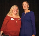 Nichole Bowling (left), a CNA at Markle Health & Rehabilitation, receives the Quest for Excellence Award from Donna Kelsey, CEO of American Senior Communities.