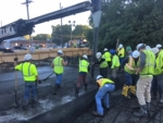 Construction workers swarm the Broadway Street bridge to rehabilitate the deck. A new concrete layer, containing a grid to run electricity, is curing now, with plans to finish and open the bridge back up to traffic within the next six months.