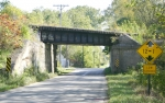 The abandoned Chicago and Erie Railroad bridge over CR 700N became the subject of debate at the Huntington County Commissioners' meeting on Monday, Oct. 5.