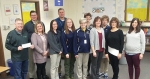CF Industries Superintendent Brad Gordon (front row at left) presents $1,350 worth of grant support to 11 Riverview Middle School teachers for innovative classroom endeavors, ranging from water studies to pollination and measurement labs. Pictured are (front row from left) Gordon, Brandi Cross, Kelly Scutt, Crystal Hippensteel, Lisa Nightingale, Patty Jacobs, Marta Waldfogel and Diana Miller; and (back row from left) Riverview Principal James Bragg, Mike Beaver, Sue Kornexl and Danna Cotton. Not pictured is Rochelle Kennedy.