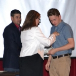 Jacob Mellendorf (right) receives his certified nurse aide pin from Tiffanney Drummond, RN, director of the CNA program at Huntington North High School, as HNHS Principal Chad Daugherty looks on.