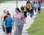 Scores of people take part in the CROP Hunger Walk on Sunday, Oct. 4, on MacGahan Street just east of Huntington North High School. In Huntington County, the fund-raiser took place in Huntington and Warren.
