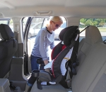 Ira Bencun, Huntington County Youth Services Bureau car seat technician, demonstrates how to properly install a car seat. The YSB offers free child seat inspections and can answer questions about child car seats.