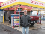 Gregg Ness stands in front of his Huntington business, Sparkle Clean Car Wash, on Monday, March 12. The car wash has been open 25 years this month and Ness recently added new state-of-the-art automatic car wash equipment in celebration of the milestone.