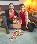 "Rachel Beachy (left) and Beth Bucher, of Dr. John Regan's dental office, are pictured with one of the boxes that was filled with candy for the troops overseas during the recent ""Cash for Candy"" Halloween event."