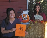 Beth Bucher (left) and Sandy Bradley, employees of Family Dentistry in Huntington, are ready to buy excess Halloween candy from trick-or-treaters.