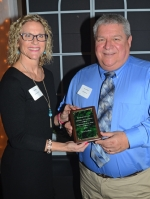 Outgoing Huntington County Chamber of Commerce Chairman of the Board Kay Schwob (left) presents Steve Godfroy, of Perfection Wheel, with the chamber's Ambassador of the Year award for 2016 at the chamber's 93rd annual dinner on Monday, Jan. 16, at the Huntington PAL.