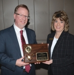 Incoming Huntington County Chamber of Commerce Chairman of the Board Sonya Foraker presents outgoing chairman Randy Warner a plaque of appreciation for his service at the annual chamber meeting Monday night, Jan. 20, a the Huntington PAL Club.
