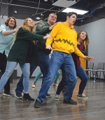 """Huntington University senior theatre performance major Andrew Bower, portraying Charlie Brown (right), leads the cast in a practice scene from the university's production of the musical """"You're a Good Man, Charlie Brown!"""" The play will be performed Feb. 27 to 29 and March 5 to 7."""