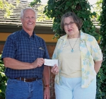 Dan Fulton (pictured left), Woodmen's Activities Coordinator, presents a $5,000 check to Susan Taylor, the Historic Forks of the Wabash president and Woodmen member, to match the Forks' fund-raising efforts. Through a fish fry, rummage sale and silent auction, the Forks was able to raise $2,500 to be matched by the Woodmen grant.