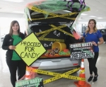 Huntington Chevrolet Office Manager Katrina Andrews (left) and Sales Representative Camarie Young show off one of the trunks Young decorated that will be part of the dealership's multi-business trunk or treat event on Halloween, Thursday, Oct. 31, from 4 p.m. to 8 p.m.