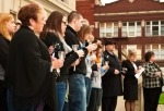 Residents and leaders from Huntington and Huntington County stand in silence during a previous vigil held in observance of National Child Abuse Month.