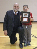 Mayor Brooks Fetters poses with Collin Flowers, a first-grade student at Horace Mann Elementary School, in Huntington, who was named the winner of the sixth annual Mayor's Christmas Card Contest on Wednesday, Nov. 28, during an assembly at Horace Mann. First and second-graders from three local elementary schools produced Christmas art for the contest. As Flowers' submission was selected as the winner, it will grace the cover of this year's mayoral Christmas card.