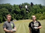 Lance Clark (left), professor of DMA Film and Communications, and Nathan Hartman, digital media arts studio supervisor, man the controls during the inaugural flight of Huntington University's new DJI Inspire UAV drone.