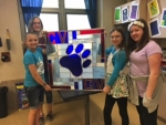 Students at Crestview Middle School show off the pawprint stained glass panel they created in art class. Pictured (from left) are Payton Sell, Catherine Taylor, Alyssa Gilpin and Kylie Morrow.