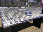 The Cost of Freedom Memorial is a series of stand-up exhibits created in gold dog tags to record the names of those who have given their lives for American Freedom since Vietnam.